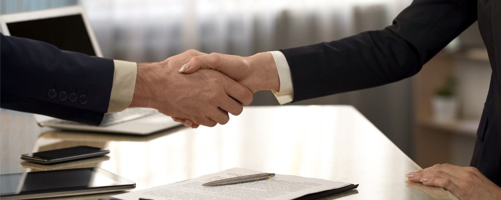 business-partners-shaking-hands-after-contract-signing-companies-picture-.jpg